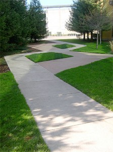 Photo of a criss-crossing sidewalk the interrupts people's conversations.